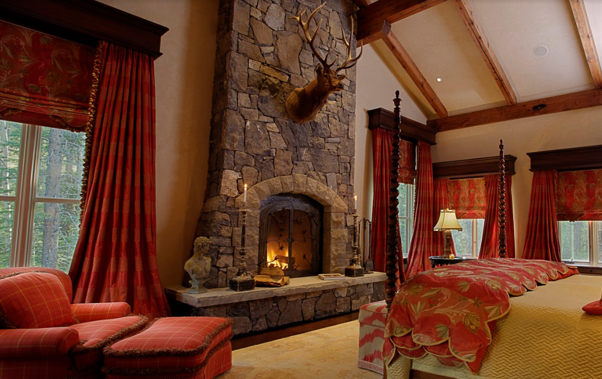 Master Bedroom with Rundlestone fireplace with sandstone acccents